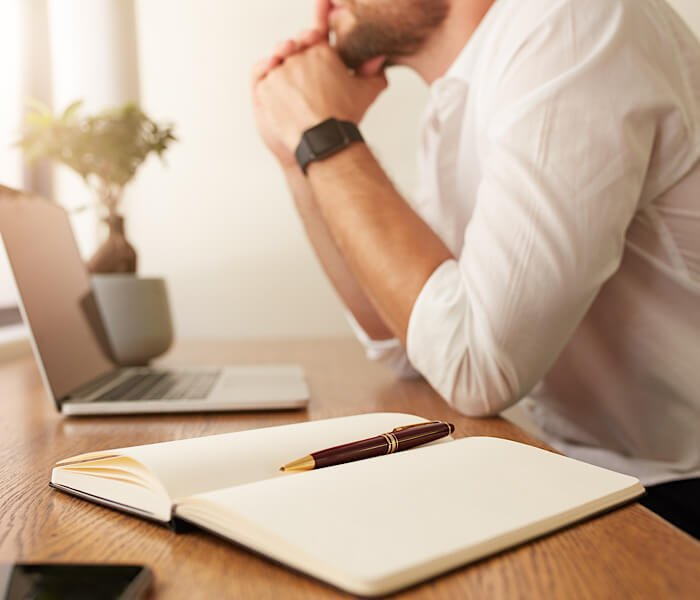man being creative thinking of writing prompts to list out
