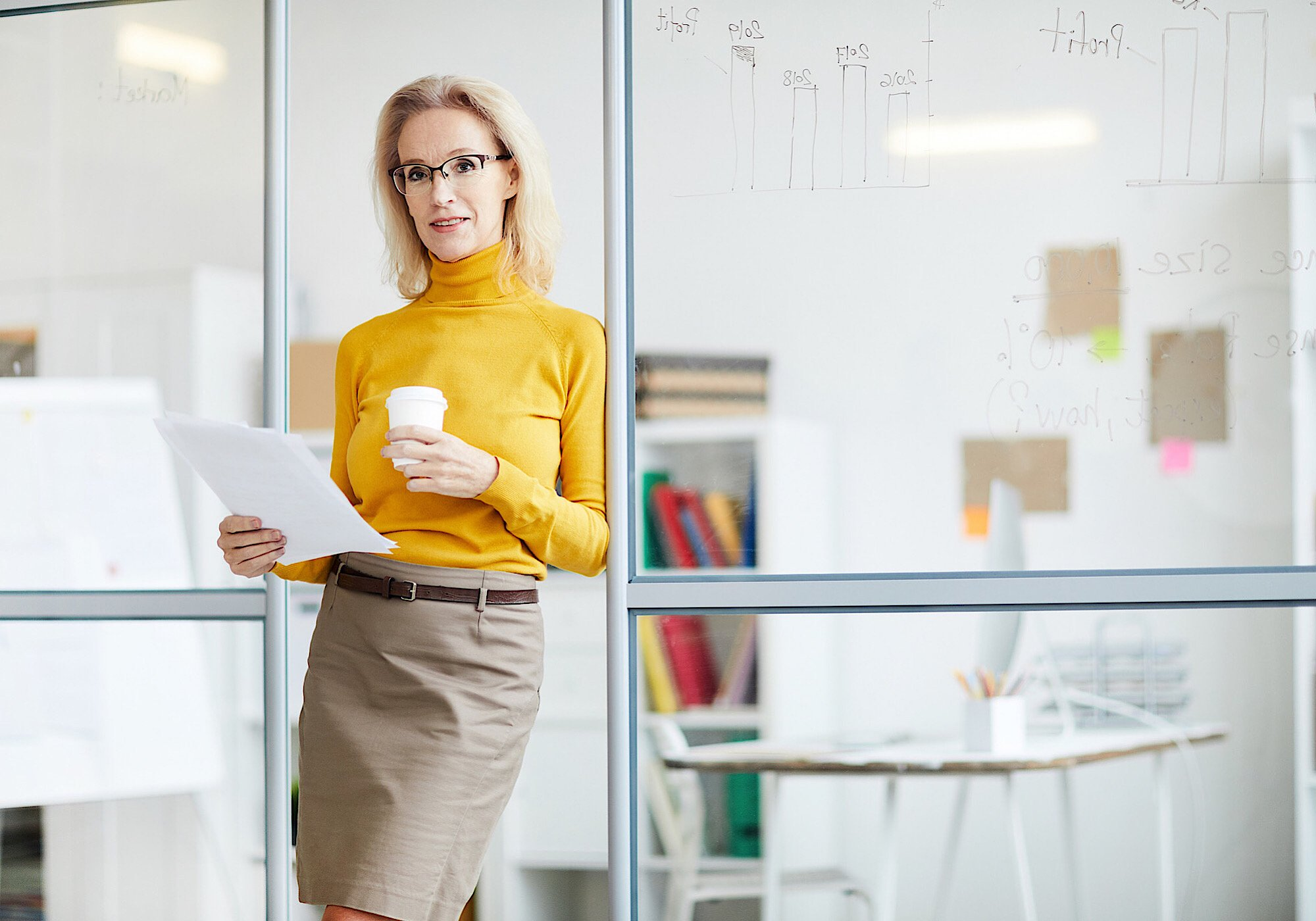 Business woman being your own boss working from home with coffee cup